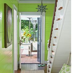 Love the painted green paneling. Key West Cottage Foyer