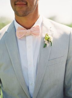 Summer is all about warm colors. Change a suit by adding warm colors to the groomsmen's attire — the peach bow tie  shown here is the perfect color for a summer wedding.