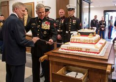 Secretary of the Navy (SECNAV) Ray Mabus and Gen. James F. Amos, Commandant of the Marine Corps, cut a cake at the Marine Corps birthday celebration at the Pentagon.