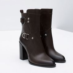 Image 4 of LEATHER ANKLE BOOTS WITH METAL RINGS from Zara