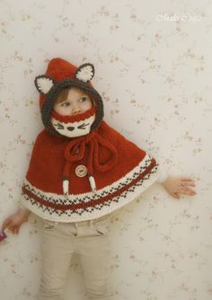 This is knitting pattern for poncho Lexi with a hood, inner cowl and cute paw-ribbon. Use this pattern for making fox, wolf, cat etc poncho. The bottom edge is decorated with simple Fair Isle pattern. Poncho Au Crochet, Poncho Knitting Patterns, Knitting Charts, Knit Crochet, Crochet Patterns, Knitting Machine, Motif Fair Isle, Fair Isle Pattern, Double Pointed Knitting Needles