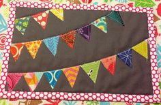 pennant mug rug. by rainbow robot, via Flickr...finally, a project for all those pieces trimmed off of my half-square triangles!!