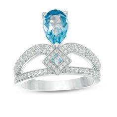 White Gold Pear-Shaped Blue Topaz and CT. Diamond Split Shank Ring A regal design she can't help but adore, this gorgeous gemstone and diamond ring speaks volumes about her standout fashion sense. Crafted in cool white gold, this stately Blue Topaz Stone, Blue Topaz Ring, Diamond Stone, Regal Design, Fashion Rings, Ring Designs, Jewelry Stores, Jewelry Rings, White Gold
