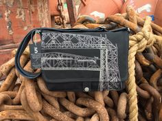 Handcrafted canvas messenger bag with a unique illustration of the Duluth Aerial Lift Bridge. Lined with a vintage ocean map print. Makes a great travel bag!