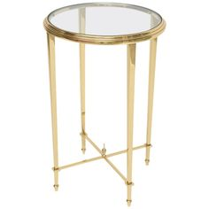"This stylish and chic brass and glass side table is inspired by the iconic firm of Maison Jansen. They are cast in solid brass that has recently been polished and lacquered. For trade price or more information please click ""Contact Dealer"" button."
