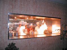Restaurant open kitchen design action which explains the growing popularity Glass Restaurant, Small Restaurant Design, Restaurant Kitchen, Restaurant Interior Design, Restaurant Interiors, Kitchen Set Up, Kitchen Design Open, Glass Kitchen, Kitchen Designs