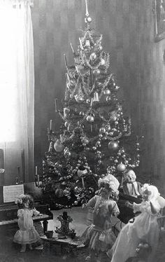 Vintage photo of a decorated large feather tree.