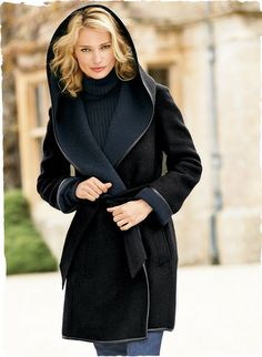 Our plush, double-faced wrap coat is sewn of felted superfine alpaca (75%), wool (15%) and nylon (10%). Trimmed in supple leather, the black exterior has a contrast navy interior. Generous hood; turn-back cuffs, buttonless placket; self-belt.