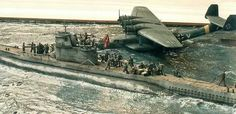Dornier DO-24 Flying boat in company with a U-boat