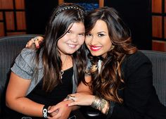 Demi Lovato poses with her younger half sister Madison De La Garza, who she credits for helping her get sober.