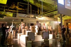 <p> Recreating a life drawing class, artists sketched nude models. Extra easels were set up for guests to create their...