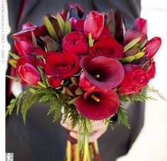 Lilies, roses and tulips made up the bride's bouquet.