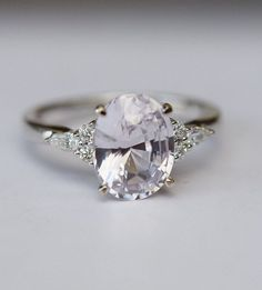 Light lavender sapphire engagement ring This ring features clean and sparkling Light Lavender sapphire. Center stone: 2.92ct light lavender natural sapphire, oval cut, clean and sparkling. The sapphire set in my Campari design, 14k white gold setting, SI/H diamonds. Accented Stones: