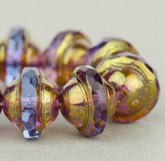Saturn Beads - Saucer Beads - Czech Glass Beads - Sapphire Blue Transparent with Antiqued Bronze Finish - 8x10mm Beads - 10 Beads @SolanaKaiBeads on Etsy #SaturnBeads #BeadStore #SolanaKaiBeads