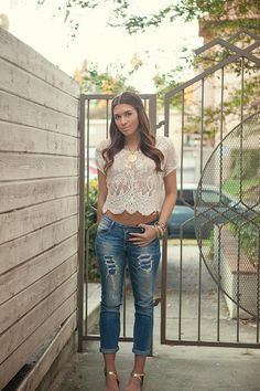 Pretty lace top with holey jeans and gold strappy heels!  Women's street style fashion