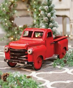 """Our eye-catching Red Farmhouse Truck boasts brilliantly red paint that has been weathered to expose metal and rust. Its vintage design makes this truck an essential focal point to your home inside or out on the porch. It measures high x wide x 10 ¼"""" deep. Classic Christmas Decorations, Rustic Christmas, Red Farmhouse, Farmhouse Decor, Vintage Farmhouse, Christmas Red Truck, Vintage Red Truck, Metal Figurines, Christmas Pictures"""