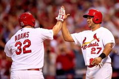 ST LOUIS, MO - OCTOBER 07: Matt Adams #32 and Jhonny Peralta #27 of the St. Louis Cardinals celebrate after a three run home run by Adams in the seventh inning against the Los Angeles Dodgers in Game Four of the National League Divison Series at Busch Stadium on October 7, 2014 in St Louis, Missouri. (Photo by Jamie Squire/Getty Images)