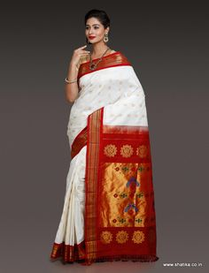 This Athiya Charming White Paithani Silk Saree balances the universe in simple zari work and dark red border in typical paithani silk patterns. This paithani silk saree grants a new color option to choose for a special wear.