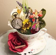 A personal favourite from my Etsy shop https://www.etsy.com/uk/listing/268061680/alice-in-wonderland-teacup-decorative