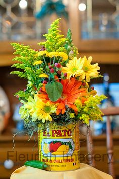 In San Antonio, we celebrate Fiesta! Wouldn't this make the cutest table decor during Fiesta season? Mexican Fiesta Party, Fiesta Theme Party, Taco Party, Mexican Theme Parties, Mexican Themed Party Decorations, Fiesta Party Centerpieces, Mexican Wedding Centerpieces, Mexican Centerpiece, Tin Can Centerpieces