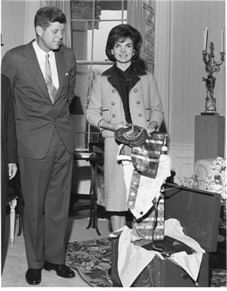 President and Mrs. Kennedy at the White House, October 1962. Jackie Kennedy is wearing the pink wool Chez Ninon she wore in Dallas, November  22, 1963...