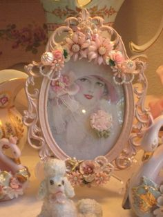 frame with the sweetest vintage embellishments and jewels, notice the pink poodle peeking between the pink flowers... I LOVE THIS SO MUCH!!