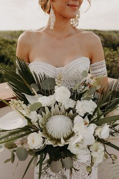 Bridal Bouquet for the bride - King Protea, Eucalyptus, Palm leaves, orchids and roses ∙ Planning, designing by Destination Weddings Tulum ( on IG) Flowers by Moni Junco ( on IG) Orchid Bouquet Wedding, Tropical Wedding Bouquets, Protea Wedding, Protea Bouquet, Palm Wedding, Boho Beach Wedding, Bride Bouquets, Wedding Flowers, Beach Flowers