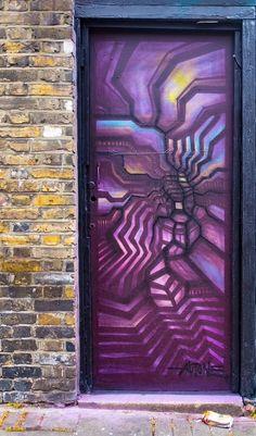 Graffiti Street Art door in London, England.