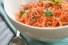 Moroccan Carrot and Date Salad | The bright flavors of carrots matched with warm spices like cinnamon, cumin, coriander and paprika make a wonderful salad for any time of year. It's a perfect make-ahead dish to take to dinner parties, as the flavors are best if left to blend for an hour before serving