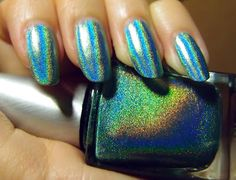 Color Club Angel Kiss - an aqua linear holographic polish. Click the image for more!