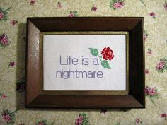Life is a nightmare framed cross stitch by lexysaurusrex on Etsy, $40.00