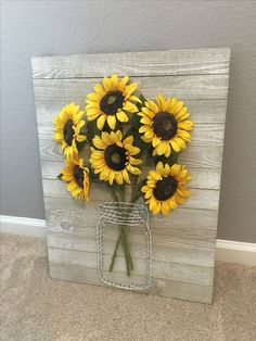 a rustic pallet sign with wire and faux sunflowers is ideal for wall decor #artsandcrafts