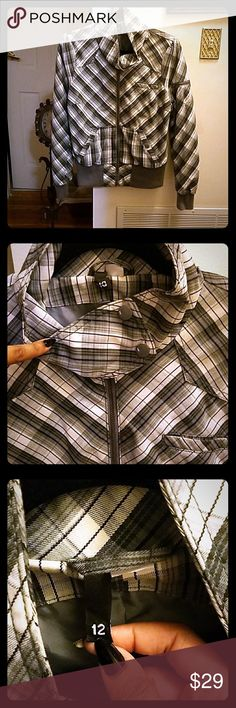 H&M Divided Grayscale Tall Collar Bomber Jacket Shades of gray in a slanted plaid design with solid gray interior lining. Worn twice for a photo shoot. There is so damage or wear or pulling or pilling of any kind anywhere on the jacket. It's literally like new. Has multiple useful pockets including a top left breast outer pocket big enough yet slim enough to house an iPhone,  a left arm outer pocket with a zipper and an interior left breast pocket big enough to fit a wallet or a cell phone…