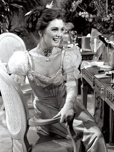 JULIANNE MOORE  Julianne Moore got the chance to play the classic good twin, evil twin soap role when she starred as both Frannie and Sabrina Hughes on As the World Turns. Moore—formerly Julie Smith—moved to New York in 1983 and two years later landed her job playing British and American half sisters with two distinct personalities.