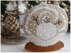 snow globe cross stitch- but I can't find the pattern....