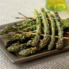 I make asparagus this way all the time, perfect for the BBQ. no sesame seeds though, brush with olive oil before cooking and add shaved parmesan reggiano cheese! (make sure to soak wooden skewers first or they will burn).