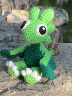 I made this based off of the plant dragon in the iPod App DragonVale. I haven't tested the written pattern, so it may have errors. Please tell me if you find any so I fix them!