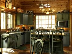 WHAT ABOUT GREEN CABINETS Lindal Cedar Homes: worldwide manufacturer of post and beam homes, solid cedar homes, custom log homes, sunrooms and room additions. Rustic Cabin Kitchens, Log Home Kitchens, Rustic Kitchen Design, Cabin Homes, Log Homes, Lindal Cedar Homes, Green Kitchen Cabinets, Cabin In The Woods, Up House