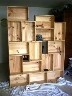 Wooden wine boxes can be arranged for an interesting wall unit