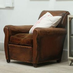 antique-leather-chair-pale-and-interesting.jpg