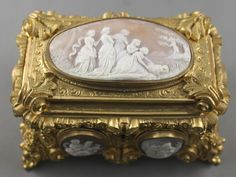 Mid 19th Century French Ormolu Jewel Casket, the lid set with a large oval shell cameo depicting Moses in the bulrushes, and the sides set with six shell cameos with various biblical scenes original papersticker to base Tahan /Fourn'r de L'Empereur a Paris, silk lined with key, 9 x 14 x 10cm