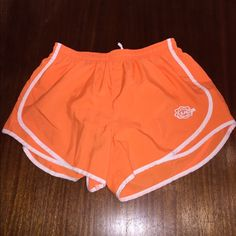 Running sports shorts Varsity UCA cheerleading running shorts. Only worn a couple times Varsity Shorts