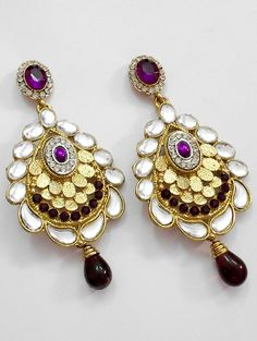 The very latest and exclusive pair of kundan earring, crafted and desinged beautifully with Kundan Stone work and the CZ stones which makes it more attractive.