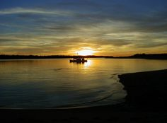 I can imagine myself lying on the raft, relishing the heat of the sunset, drifting down the lazy Mississippi river.