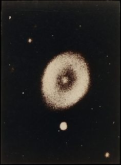 Taken by Prosper Henry, 1885.  This photograph of the Ring Nebula in the constellation Lyra shows but a three-degree section of the firmament, 1,956 light-years from earth. Once a star similar to our own sun, the nebula was formed when the star exploded, releasing gasses from its outer shell into space.