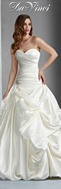 DaVinci Bridal Style # 50004 Satin gown with drop waist, and sweetheart strapless neckline. Asymmetrical wrapping of the waist accented with a beading at the hip and beneath the back closure. Full bustled skirt with a bubble hem.  Lace-up back. http://www.davincibridal.com/
