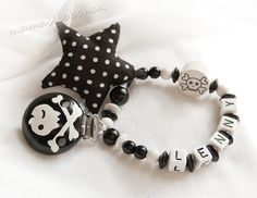 Pacifier chain / Dummy holder, keeper personalized with name, skull clip, star rattle and plastic letter beads, black & white (item 19601)