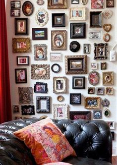 a giant collection of tiny picture frames - gallery wall