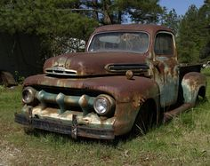 https://flic.kr/p/HT1PT   1951 Ford F1 Pickup.jpg   Old rusted Ford pickup truck, alongside US15S, about 2 miles north of Stoval, North Carolina  5/07/07  Update:; Per  HubcapCafe.com [www.hubcapcafe.com/ocs/pages01/f1005102.htm] this is a 1951 Ford F-1 Pickup Truck