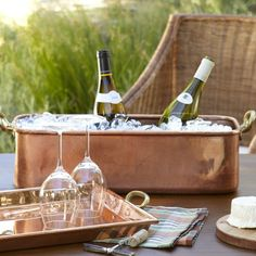 Matching copper ice bucket and bar tray serve up wine outdoors at the beach.